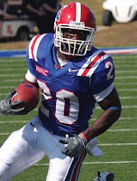 Louisiana Tech football player carries the ball.