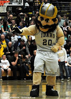 Idaho Vandal mascot in basketball uniform at basketball game.