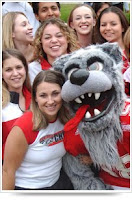 UNM mascot with girls before a football game.