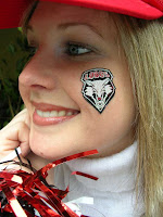 UNM face paint on cute girl's cheek.
