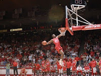 University of New Mexico basketball player dunks two basketballs at once.