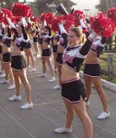 SDSU cheerleaders raise pom poms.