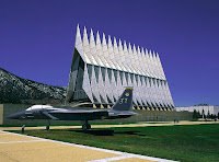 Airplane and tall art on Air Force Academy campus.