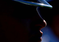 Air Force darkened face with shining black hat.