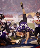 TCU football player dives for a touchdown.