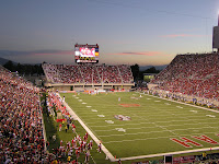 Full University of Utah football stadium during a game.