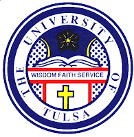 Round seal with blue writing saying The University of Tulsa with a yellow cross in the interior with the words Wisdom Faith Service written in the center of the circle.