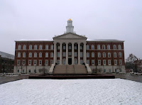 Colonial style building on the Southern Methodist University campus with snow on the ground in front of the building.