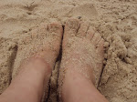 Com os pés n`areia