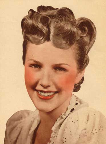 victory roll hairstyle. known as Victory Rolls.