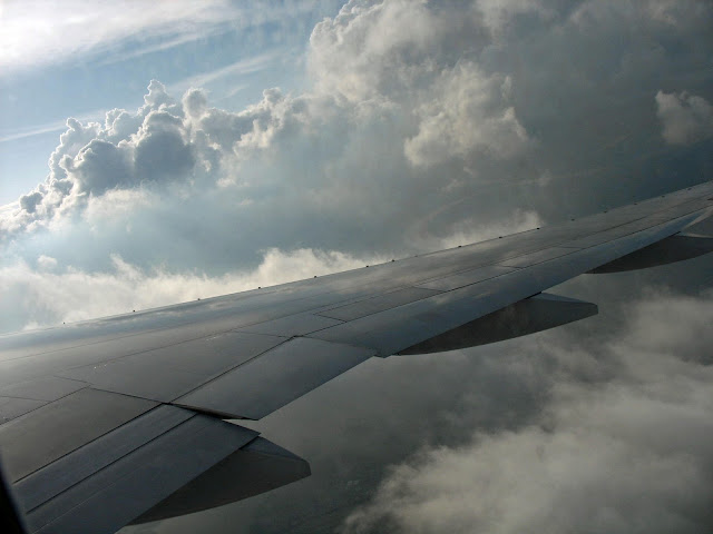 plane wing going through clouds