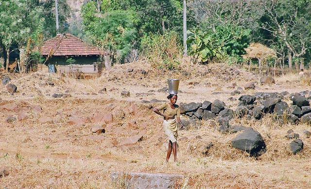 tribal woman with bucket on head