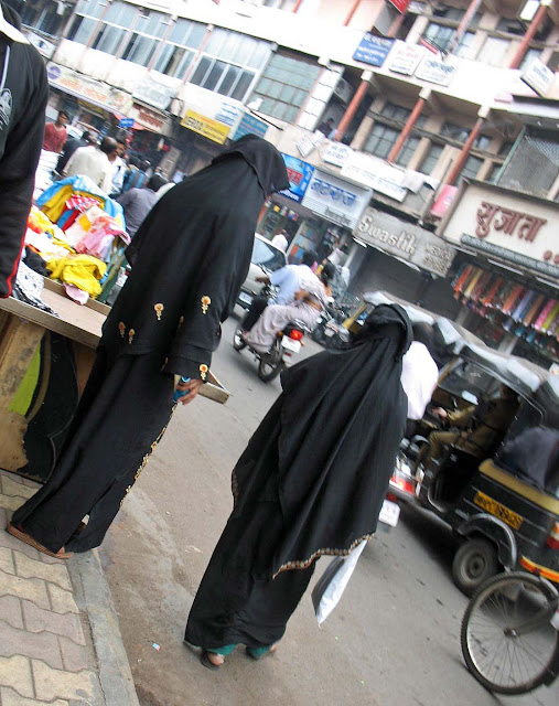 burkha clad women on a busy road
