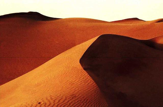 sand dunes against white background