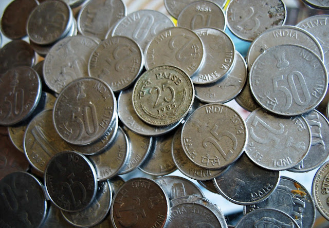 coins of 50 paise and 25 paise