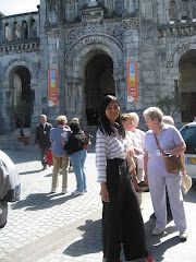IN FRONT OF THE PARISH CHURCH OF LOURDES