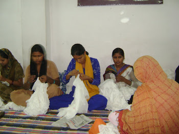 women in Delhi sewing beads by hand