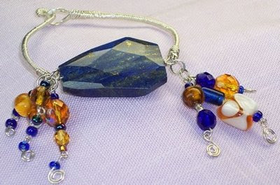 Wire Wrapped 28mm x 40mm Faceted Lapis bracelet by Jannadu shop on etsy