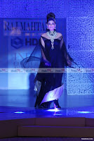 Raveena Tandon walks with Black outfit and Jewellery for Raj Mahtani at HDIL Fashion Show