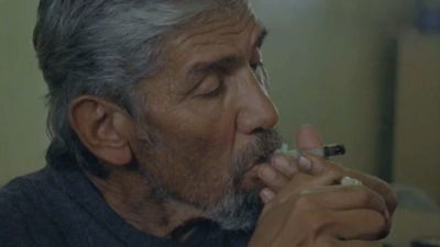 Old man smoking joints