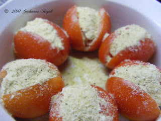 Sprinkle Parmesan and Romano Cheese on top of Italian Stuffed Tomatoes