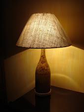 luminária com garrafa de champangnhe