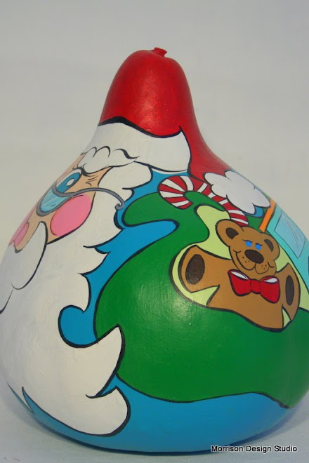 Santa Gourd - peeking into his toy bag.