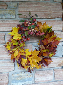 Wreath with maple leaves and grabapples
