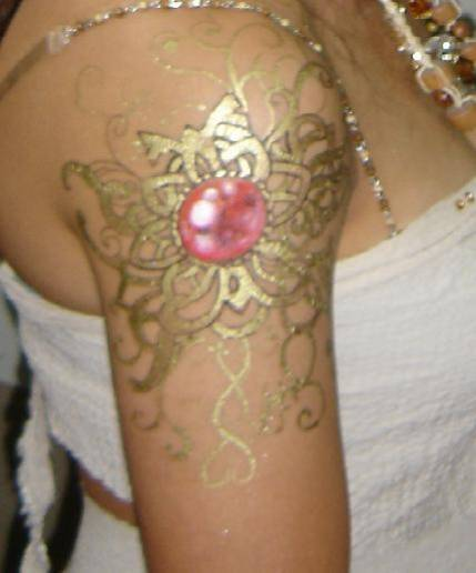 24 carat gold tattoo in dubai for Gold ink tattoos