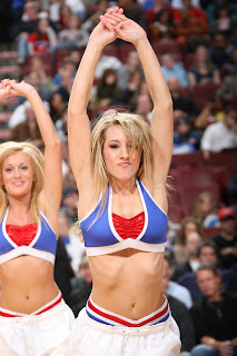 Young Sixers cheerleader stretches.