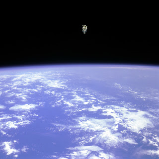 Bruce McCandless about 100 meters from the Shuttle