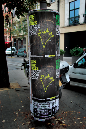 Outdoor poster of the Nike Take Antwerp campaign with a QR code