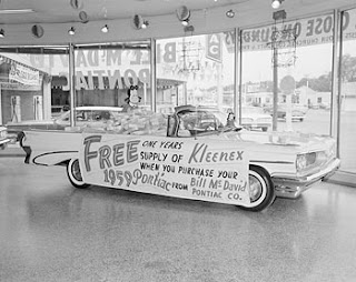 Bill Wood photograph of a promotion. One year of free Kleenex if you buy a Pontiac!