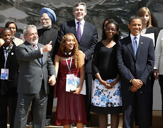 Brazilian President Luiz Inacio Lula da Silva poses with his junior G8 delegate Mayora Tavares as other leaders, including U.S. President Barack Obama gather for a group picture at the G8 Summit in L'Aquila July 9, 2009