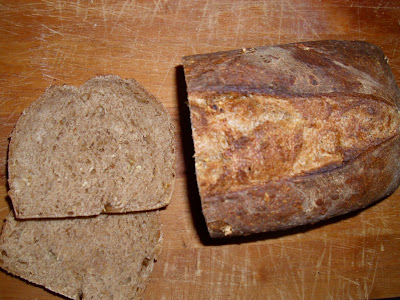 Baked bread with a slice cut off