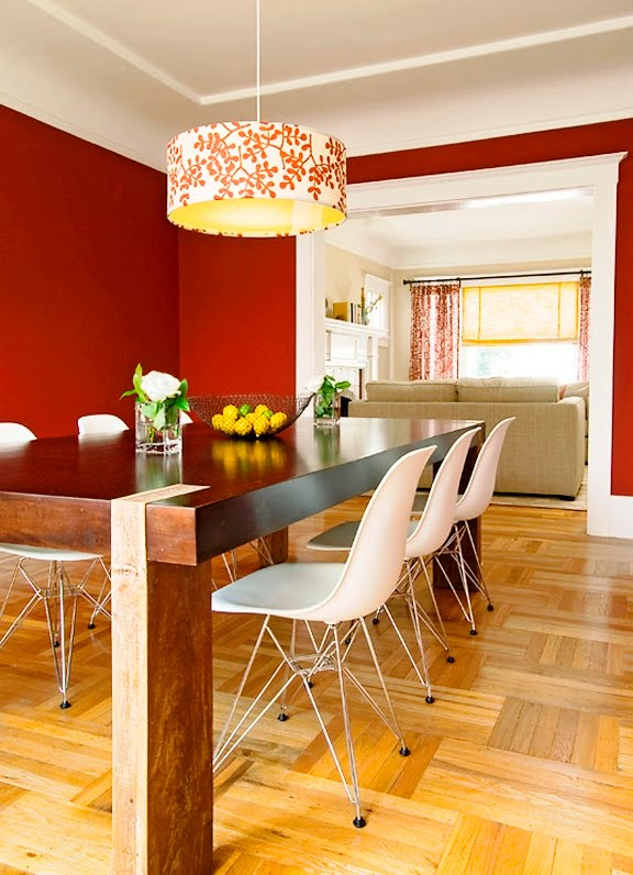 Dining room after Niche Interiors' redesign with red paint, modern farmhouse style dying table and a hand painted chandelier
