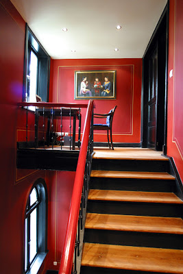 Red staircase leading up to a red landing
