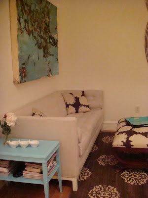 NYC loft lounge with a Jonathan Adler sofa and a turquoise side tables