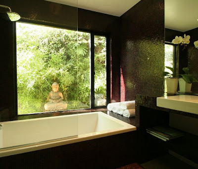 Zen inspired master bathrooom after The Sunset Team/La Kaza Design's remodeling with mosaic tiles covering the walls, bath and vanity area, a picture window with a view of a bamboo garden and a Buddha statue