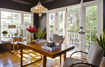 Home office by Jeff Andrews with French doors, a mid century modern desk, armchair and alabaster chandelier