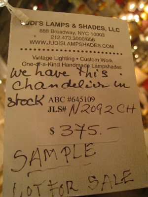 Note on the price tag of a tiered teardrop lamp from Judi's Lamps & Shades