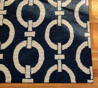 Blue and cream wool rug with a chain pattern from Pottery Barn
