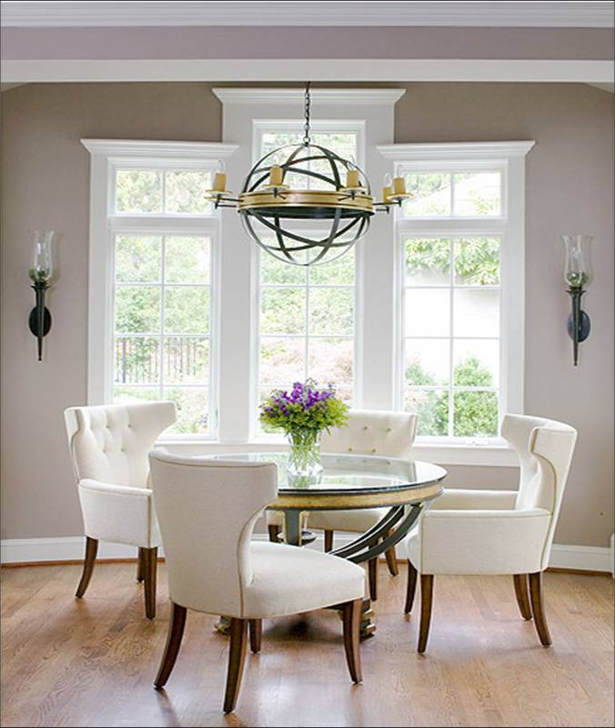 chairs round glass table round chandlier paned windows wood