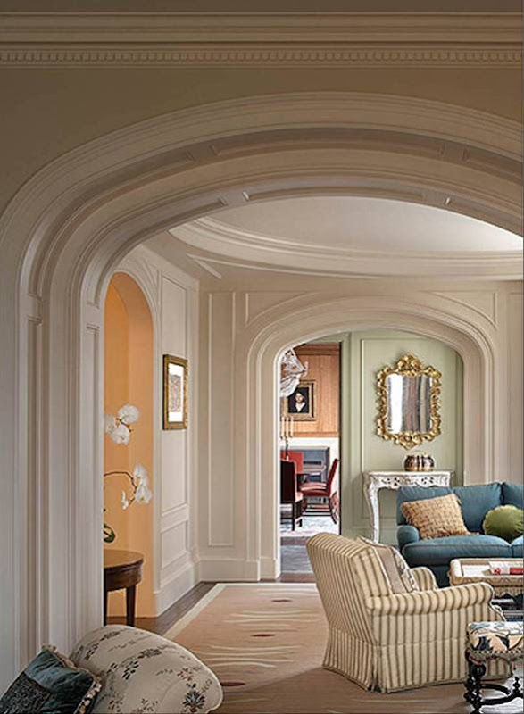 Detail of the crown moulding in a sitting room in a New York Apartment designed by Katie Leede