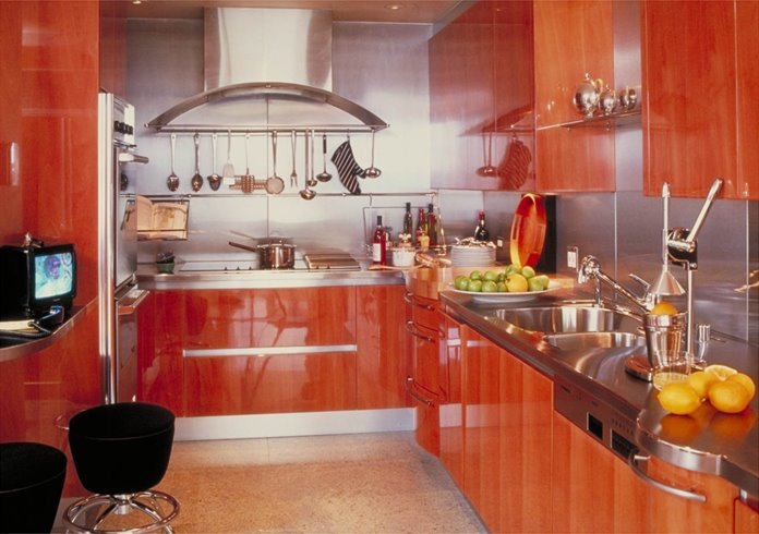 High glossy kitchen with lacquered exotic wood cabinets and drawers, stainless steel backsplash and glossy floor
