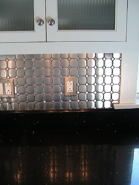 Kitchen after remodeling with stainless steel tile Diamond Tech-Metal Series Mosaic Octagon Dots backsplash