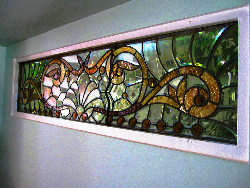 Rectangular stained glass window in a dining room