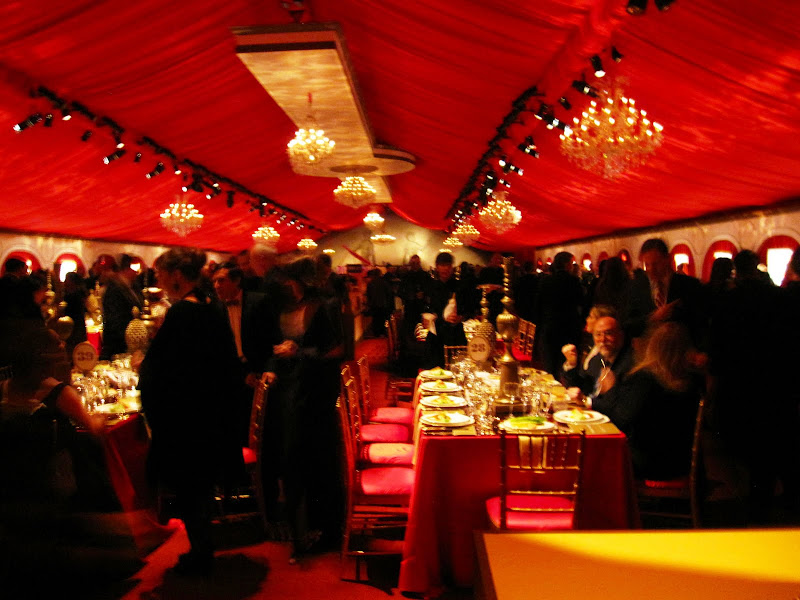 The tent was draped in red with large crystal chandeliers