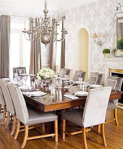 dining room all in grey features a very grand silver chandelier above