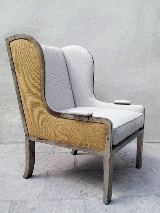 wingback chair with iron base and upholstered seat and bac